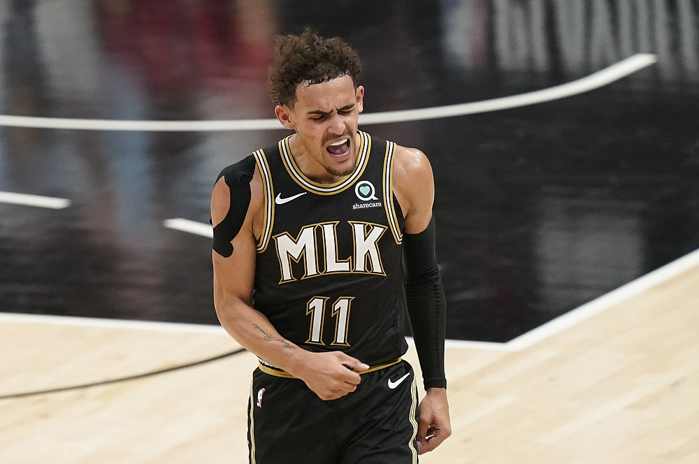 Atlanta Hawks' Trae Young (11) reacts after he scores during the second half of Game 4 of a second-round NBA basketball playoff series against the Philadelphia 76ers on Monday, June 14, 2021, in Atlanta. (AP Photo/Brynn Anderson)