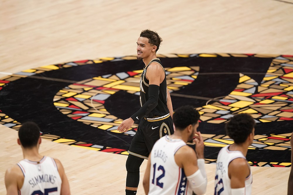 Atlanta Hawks' Trae Young, top, smiles at the end of the second half of Game 4 of a second-round NBA basketball playoff series against the Philadelphia 76ers, Monday, June 14, 2021, in Atlanta. (AP Photo/Brynn Anderson)