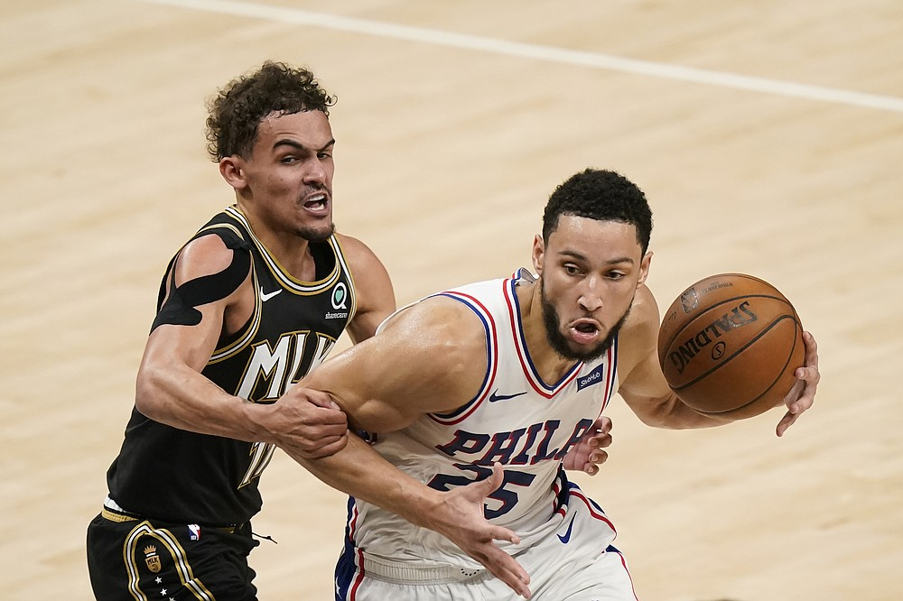 Atlanta Hawks' Trae Young (11) fouls Philadelphia 76ers' Ben Simmons (25) during the first half of Game 4 of a second-round NBA basketball playoff series on Monday, June 14, 2021, in Atlanta. (AP Photo/Brynn Anderson)