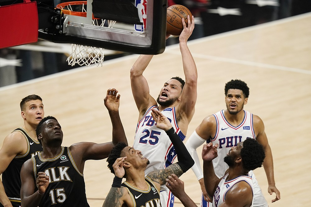 Philadelphia 76ers' Ben Simmons, top center, shoots against Atlanta Hawks' Clint Capela (15), John Collins, bottom center, and Bogdan Bogdanovic, back left, during the first half of Game 4 of a second-round NBA basketball playoff series on Monday, June 14, 2021, in Atlanta. (AP Photo/Brynn Anderson)