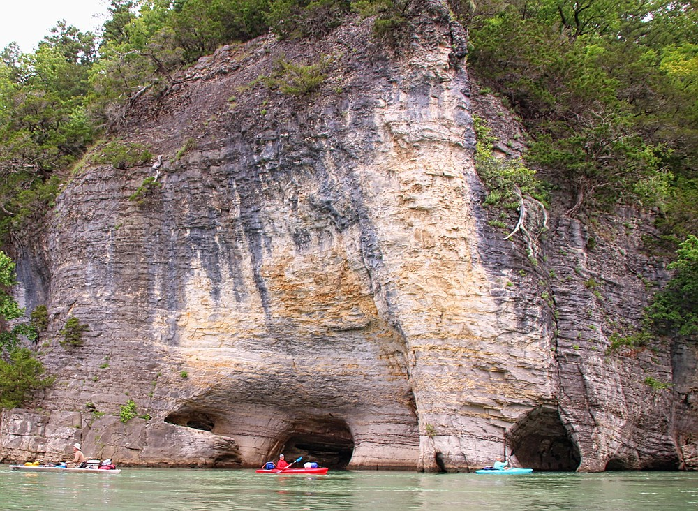Members of the Arkansas Nature Lovers Meetup group check out Skull Rock during a three-day camping float trip May 28-30, 2021, on the lower Buffalo National River.  (Special to the Democrat-Gazette/Bob Robinson)