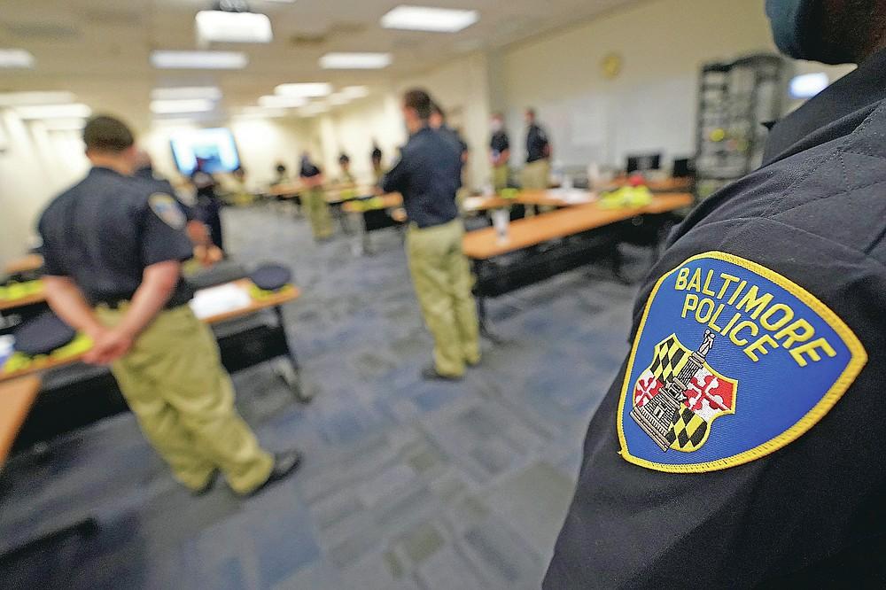 In this Sept. 9, 2020, photo Baltimore Police Academy cadets listen to an instructor during a class focusing on procedural justice in Baltimore. (AP Photo/Julio Cortez)