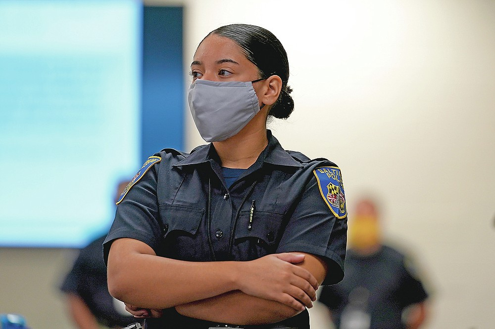 In this Sept. 9, 2020, photo Kaley Garced, a cadet in the Baltimore Police Department, listens to an instructor during a class session focusing on procedural justice in Baltimore. (AP Photo/Julio Cortez)