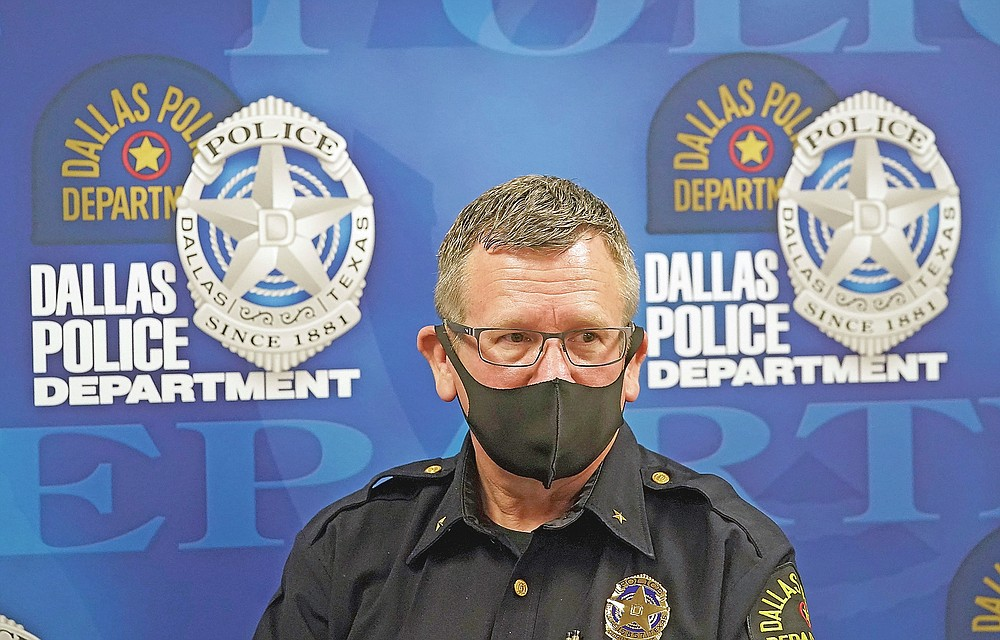 In this May 11, 2021, photo wearing a mask to prevent the spread of COVID-19, Dallas deputy police chief William Griffith prepares for an interview about recruiting cadets for the department in Dallas. (AP Photo/LM Otero)