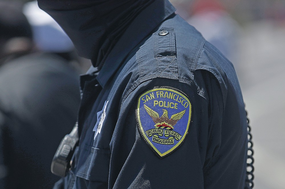FILE - In this July 7, 2020, file photo a San Francisco Police Department patch is shown on an officer's uniform in San Francisco. Law enforcement agencies across the country experienced a wave of retirements and departures and are struggling to recruit the next generation of police officers in the year since George Floyd was killed by a cop. And amid the national reckoning on policing, communities are questioning who should become a police officer today. (AP Photo/Jeff Chiu, File)