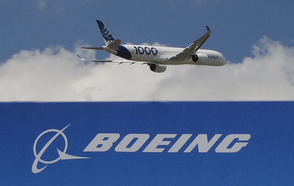 FILE - In this June 17, 2019, file photo, an Airbus A 350 - 1000 performs a demonstration flight at Paris Air Show in Le Bourget, east of Paris, France. The United States and the European Union on Tuesday appeared close to clinching a deal to end a damaging dispute over subsidies to Airbus and Boeing and lift billions of dollars in punitive tariffs. (AP Photo/Michel Euler, FILE)