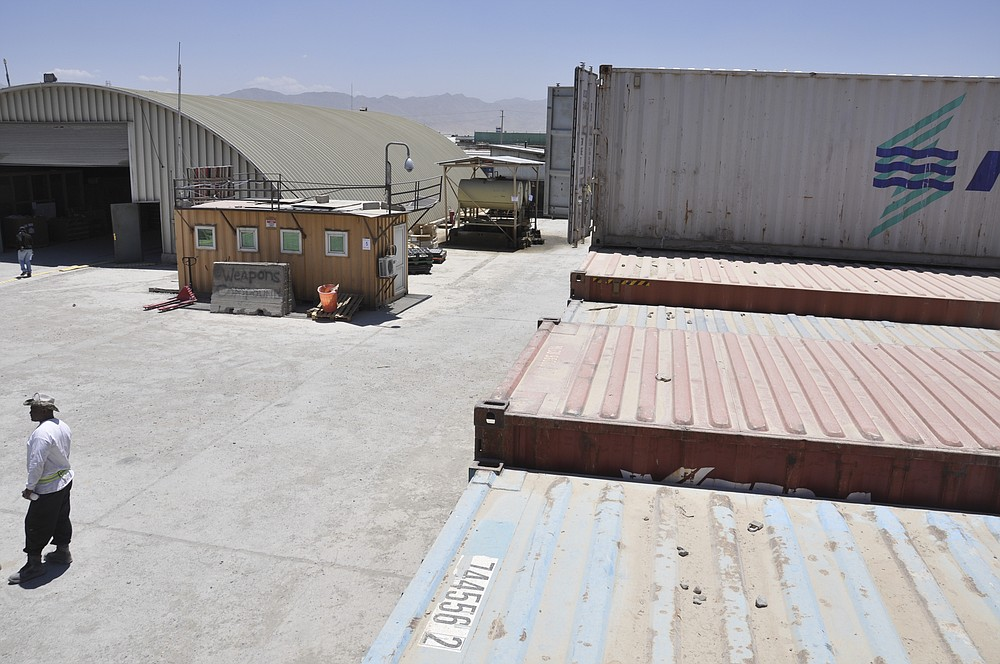 This July 1, 2012, photo released by the U.S. Army Criminal Investigation Command on Feb. 26, 2021, shows a U.S. Army storage yard in Kabul, Afghanistan. Army investigators determined that 65 handguns had been stolen from a cargo container. The theft went undetected until empty pistol boxes were discovered on the compound and a full inventory was taken. (U.S. Army Criminal Investigation Command via AP)