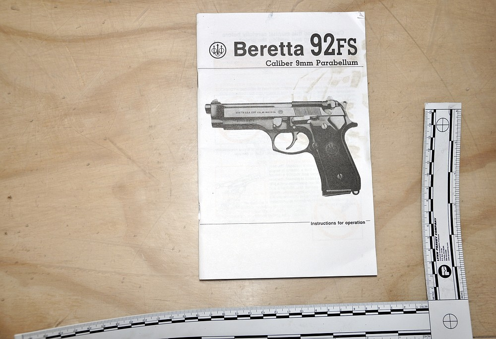This July 1, 2012, photo released by the U.S. Army Criminal Investigation Command on Feb. 26, 2021, shows an instruction manual for a Beretta 9mm handgun at an Army storage yard in Kabul, Afghanistan. Army investigators determined that 65 handguns had been stolen from a cargo container. The theft went undetected until empty pistol boxes were discovered on the compound and a full inventory was taken. (U.S. Army Criminal Investigation Command via AP)