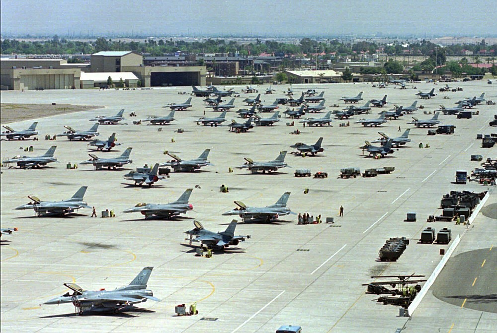 General Dynamics F-16 Fighting Falcons sit on the tarmac at Luke Air Force Base in Glendale, Ariz. Fort Smith city directors on Tuesday committed money from the city's general fund for a runway extension to accommodate a Singaporean F-16 training unit at Ebbing Air National Guard Base.   (File Photo/AP/Ken Levine)