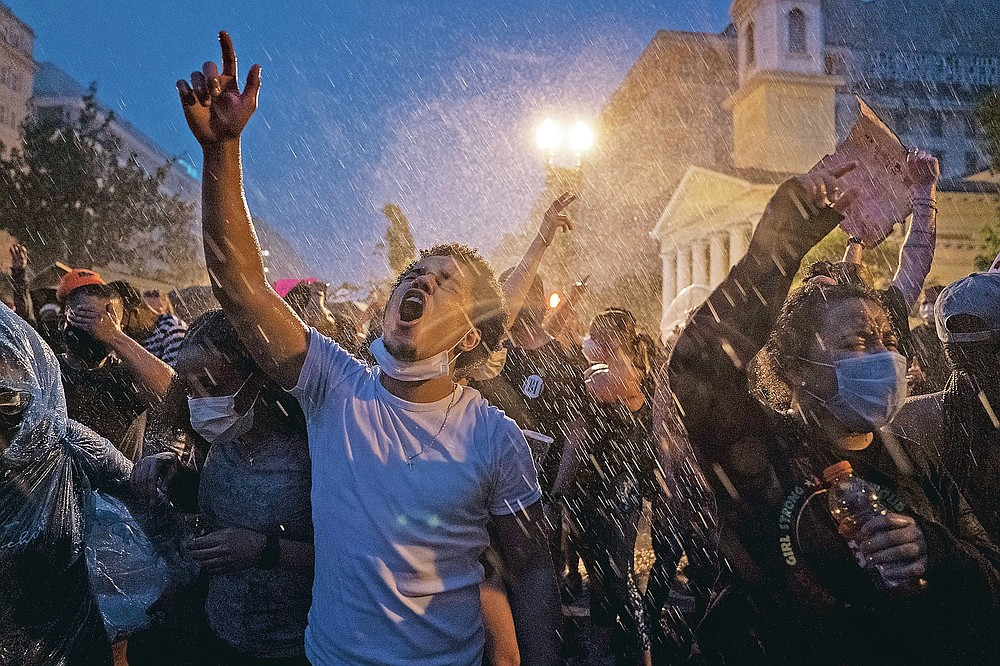 Demonstrators protest, June 4, 2020, near the White House in Washington, D.C., over the death of George Floyd. The image was part of a series of photographs by The Associated Press that won the 2021 Pulitzer Prize for breaking news photography. (AP Photo/Evan Vucci)