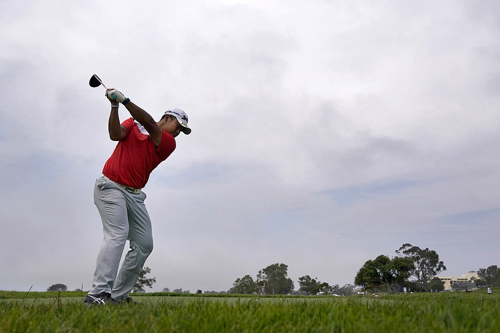 Hideki Matsuyama, of Japan, plays his shot from the 14th tee during a practice round of the U.S. Open Golf Championship, Wednesday, June 16, 2021, at Torrey Pines Golf Course in San Diego. (AP Photo/Gregory Bull)