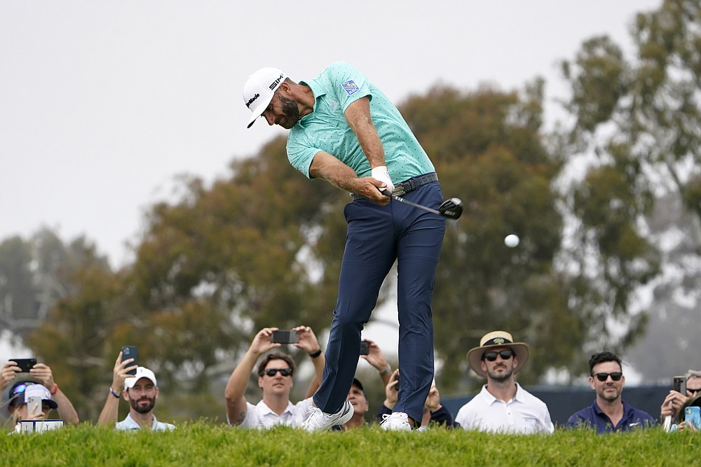 Dustin Johnson plays his shot from the second tee during a practice round of the U.S. Open Golf Championship, Wednesday, June 16, 2021, at Torrey Pines Golf Course in San Diego. (AP Photo/Jae C. Hong)