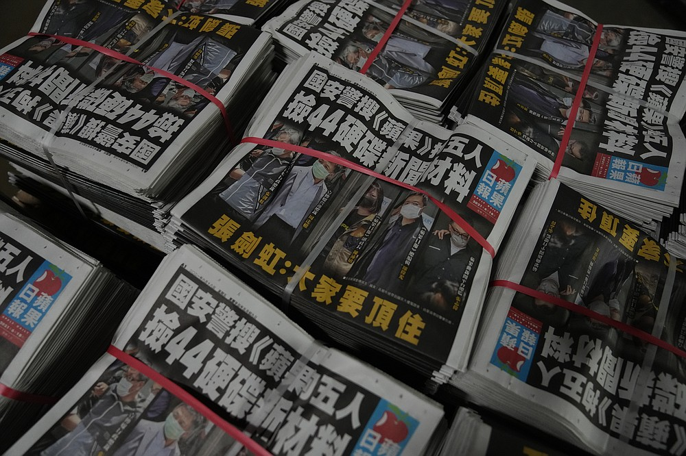 Copies of Apple Daily newspaper are packed at the printing house in Hong Kong, early Friday, June 18, 2021. Five editors and executives at pro-democracy Apple Daily newspaper were arrested Thursday under Hong Kong's national security law, its stock was halted and police were searching its offices in moves raising concerns about the media's future in the city. (AP Photo/Kin Cheung)