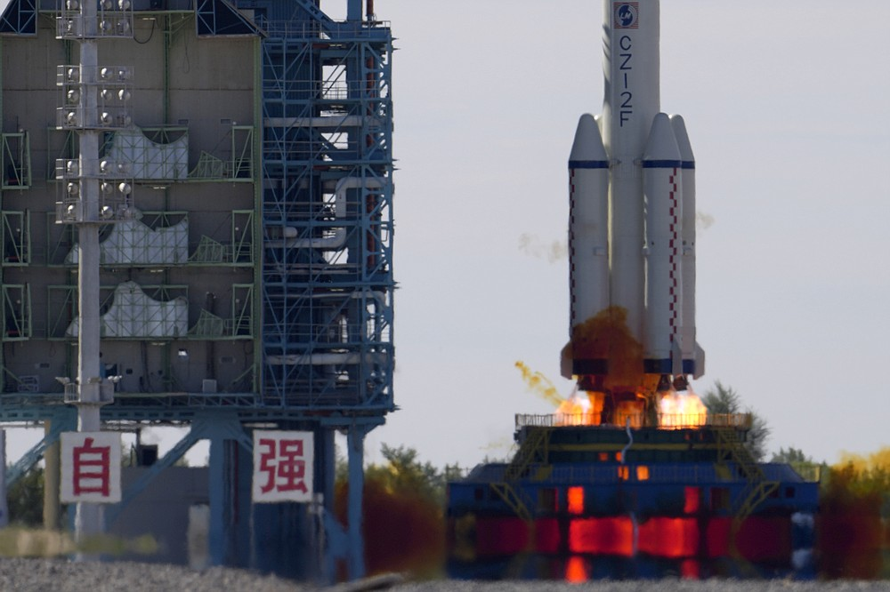 A Long March-2F Y12 rocket carrying a crew of Chinese astronauts in a Shenzhou-12 spaceship lifts off at the Jiuquan Satellite Launch Center in Jiuquan in northwestern China, Thursday, June 17, 2021. China has launched the first three-man crew to its new space station in its the ambitious programs first crewed mission in five years. (AP Photo/Ng Han Guan)