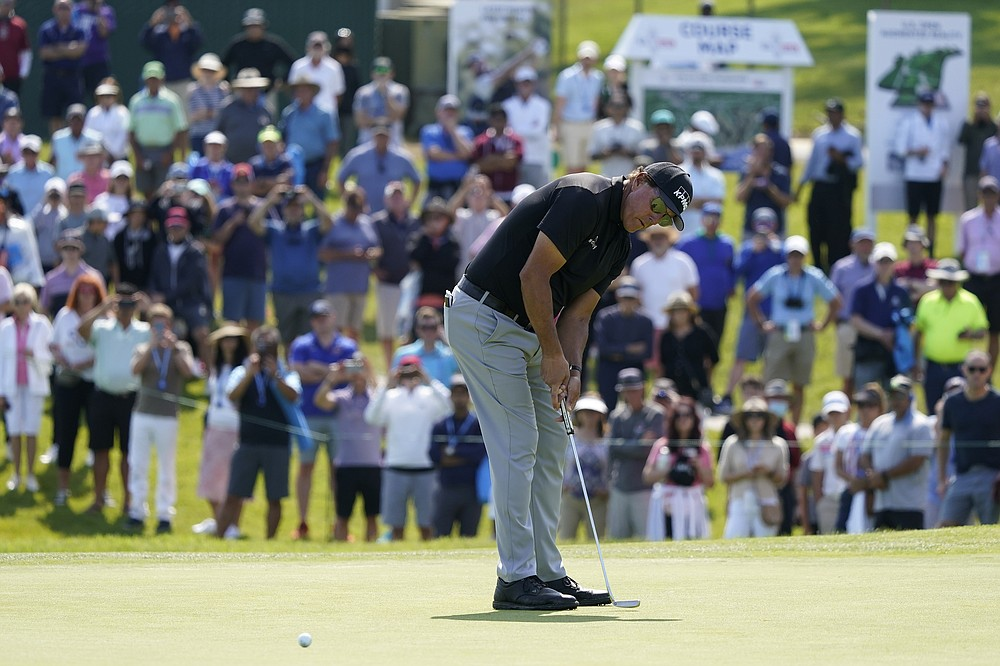 Fans watch as Phil Mickelson putts on the 11th green during the first round of the U.S. Open Golf Championship, Thursday, June 17, 2021, at Torrey Pines Golf Course in San Diego. (AP Photo/Marcio Jose Sanchez)