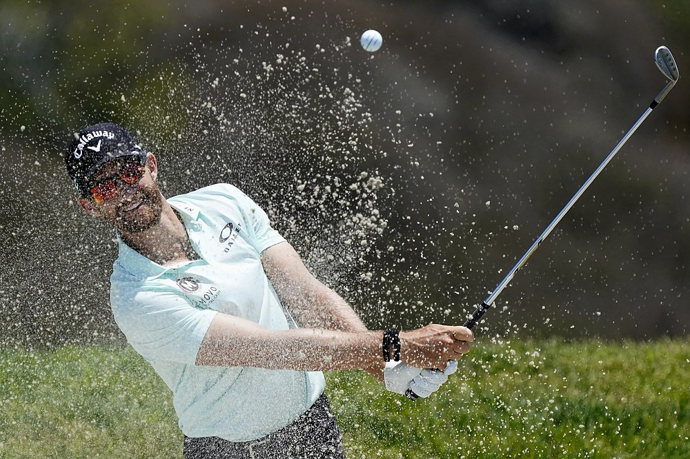 Patrick Rodgers plays a shot from a bunker on the 16th hole during the first round of the U.S. Open Golf Championship, Thursday, June 17, 2021, at Torrey Pines Golf Course in San Diego. (AP Photo/Marcio Jose Sanchez)