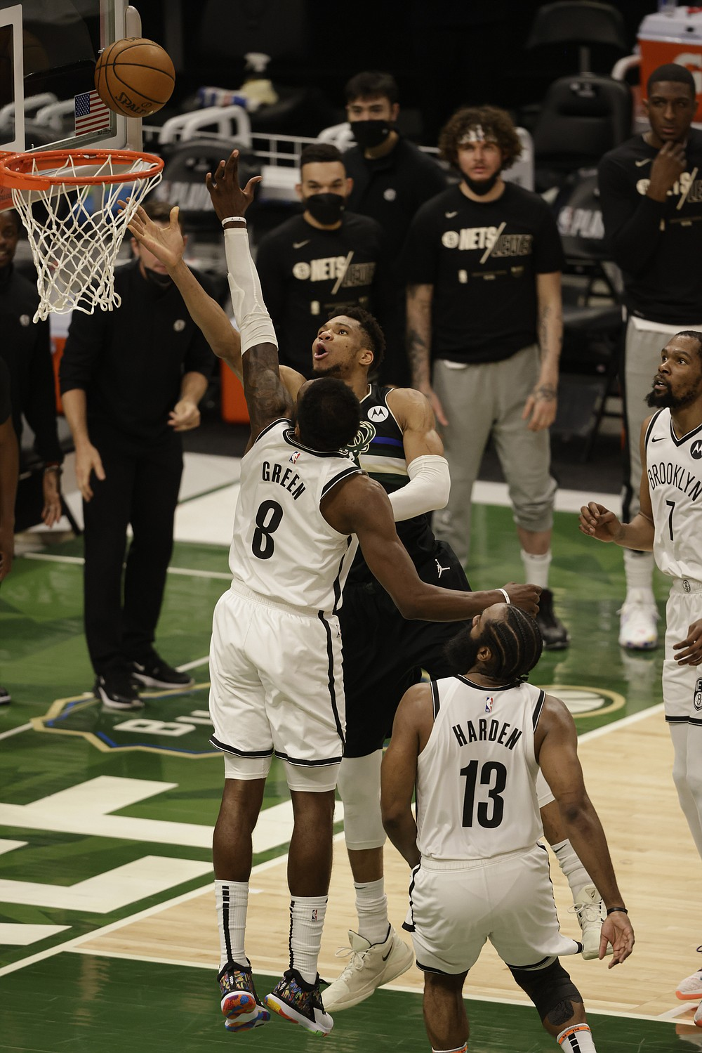 Milwaukee Bucks forward Giannis Antetokounmpo (34) shoots against Brooklyn Nets forward Jeff Green (8) during the second half of Game 6 of a second-round NBA basketball playoff series Thursday, June 17, 2021, in Milwaukee. (AP Photo/Jeffrey Phelps)