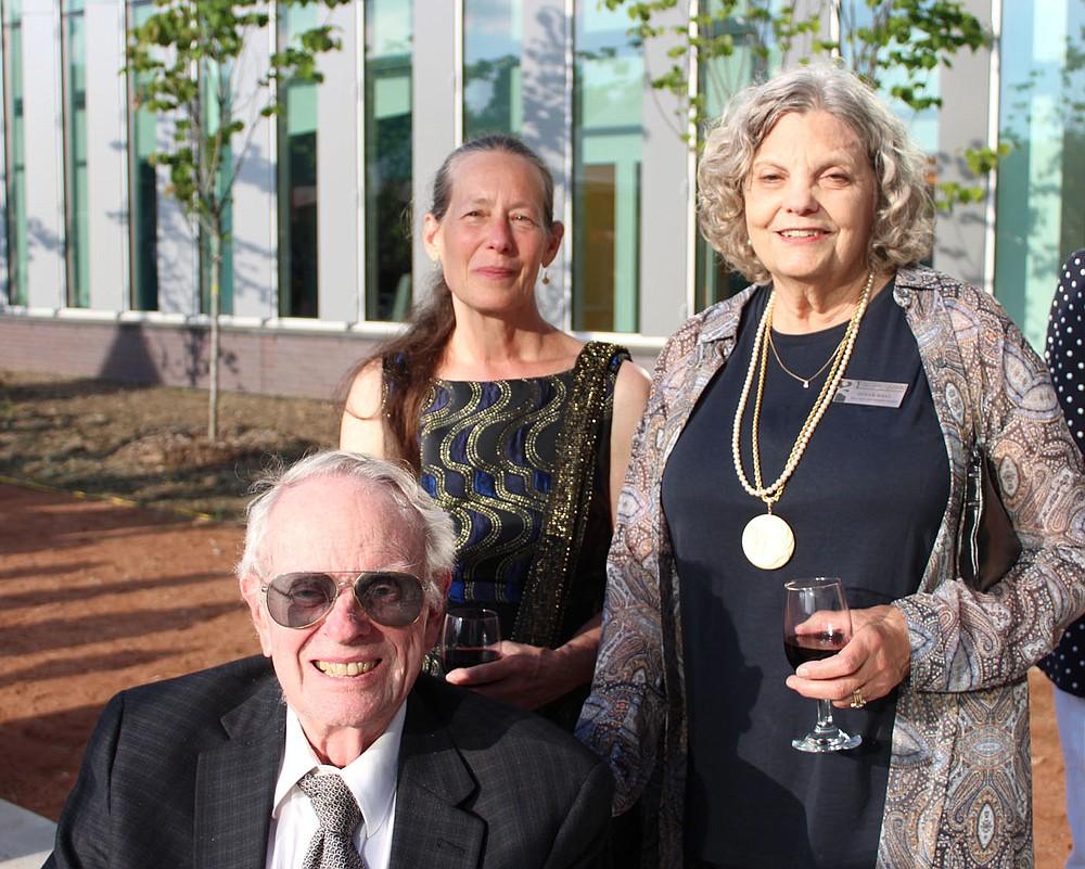 Jeannine Durdik (center) and Orville and Susan Hall enjoy the T2 fundraiser. (NWA Democrat-Gazette/Carin Schoppmeyer)