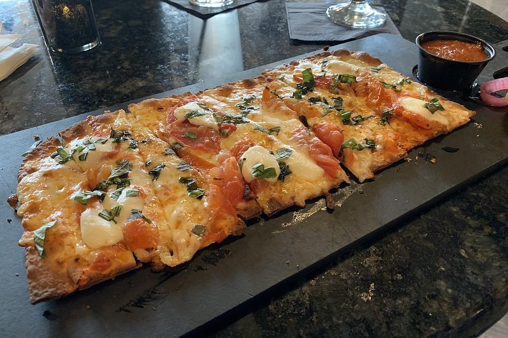 The Margherita Flabread is one of three pizza-like flatbreads on Cannibal & Craft's menu. (Arkansas Democrat-Gazette/Eric E. Harrison)