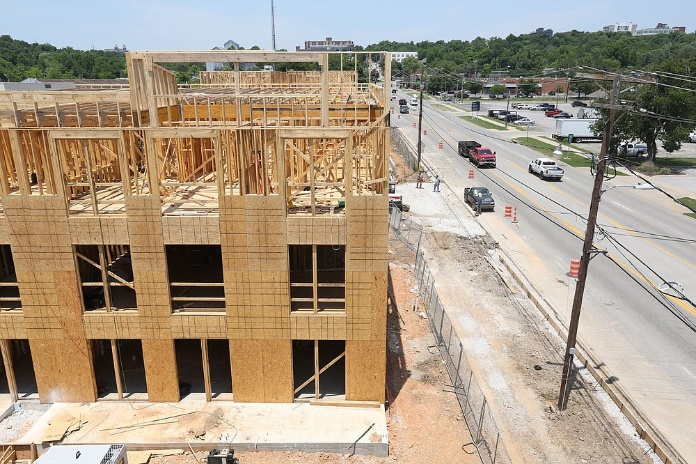 A view of the apartment construction from the third floor Thursday, June 17, 2021, at the South Yard in Fayetteville. The project lies between elements of the city's U.S. 71B corridor project to the east and the University of Arkansas Windgate Art and Design District to the west, and plans to open apartments for lease early next year. Check out nwaonline.com/210620Daily/ and nwadg.com/photos for a photo gallery. (NWA Democrat-Gazette/David Gottschalk)