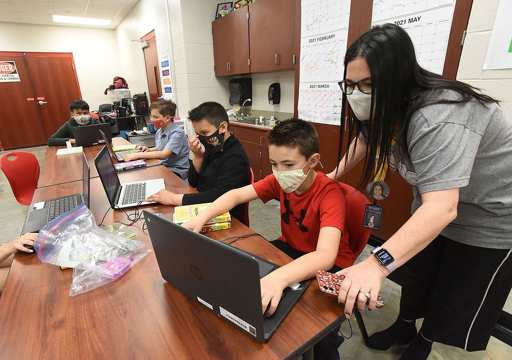 Regina Stewman, principal, visits with students on Friday April 9 2021 at Sonora Elementary in Springdale. The school is on a five-year plan to become a school of innovation.  (NWA Democrat-Gazette/Flip Putthoff)