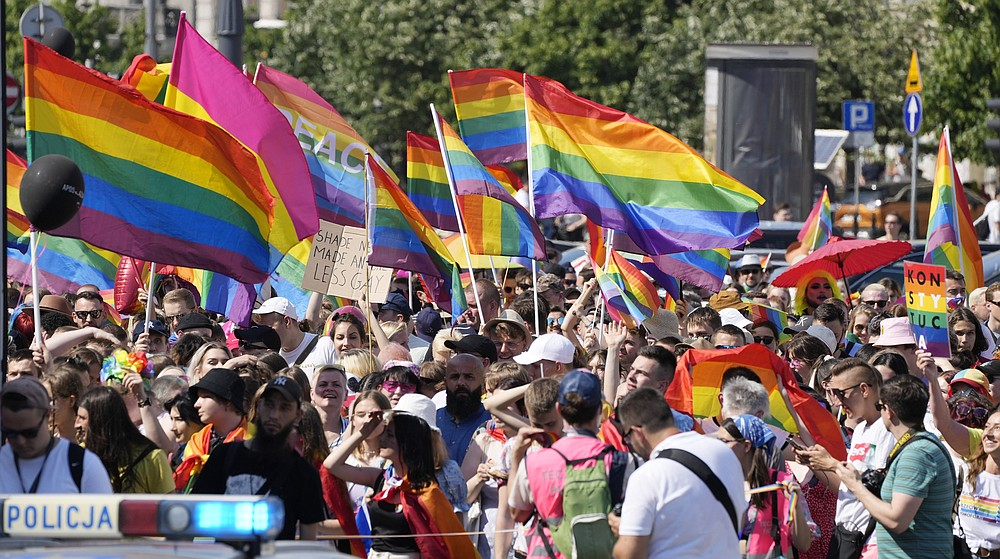 People take part in the Equality Parade, the largest gay pride parade in central and eastern Europe, in Warsaw, Poland, Saturday June 19, 2021. The event has returned this year after a pandemic-induced break last year and amid a backlash in Poland and Hungary against LGBT rights.(AP Photo/Czarek Sokolowski)