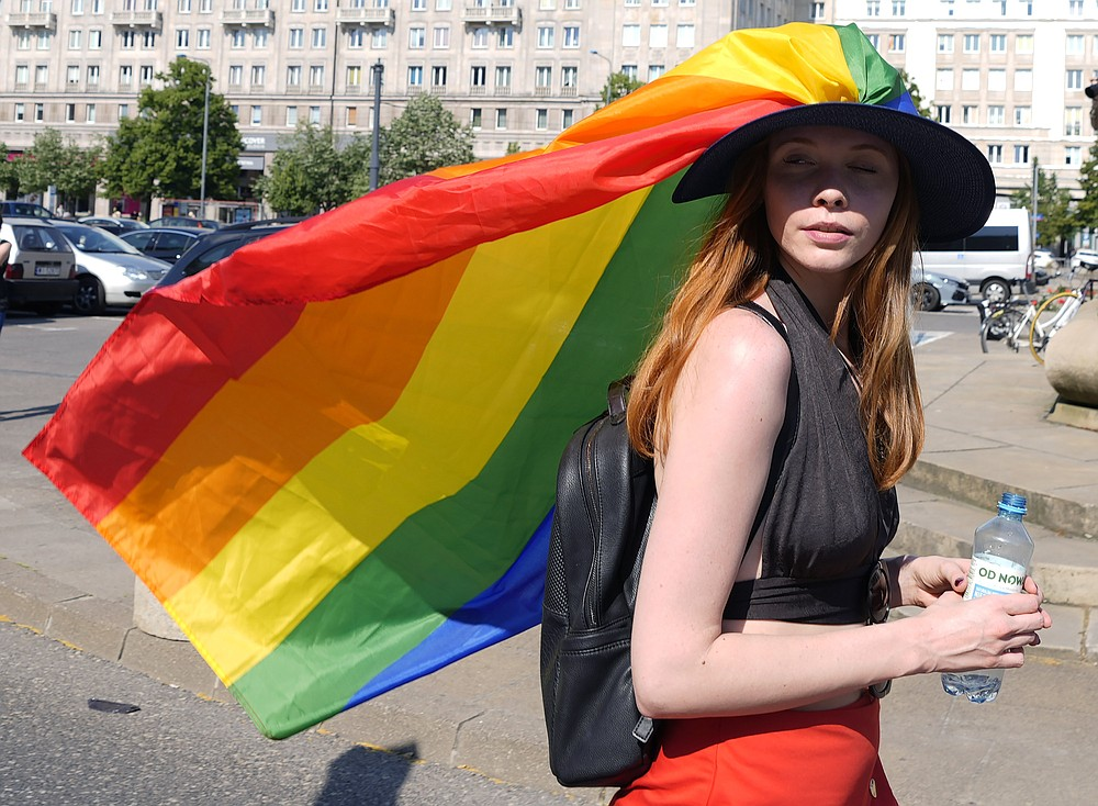 A woman take part in the Equality Parade, the largest gay pride parade in central and eastern Europe, in Warsaw, Poland, Saturday June 19, 2021. The event has returned this year after a pandemic-induced break last year and amid a backlash in Poland and Hungary against LGBT rights.(AP Photo/Czarek Sokolowski)