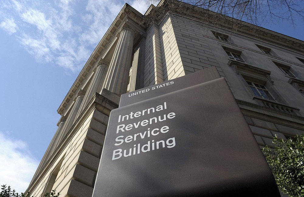 FILE - In this photo March 22, 2013, file photo, the exterior of the Internal Revenue Service (IRS) building in Washington. As ransomware attacks surge, the FBI is doubling down on its guidance to affected businesses: Don't pay the cybercriminals. But the U.S. government also offers a little-noticed incentive for those who do pay: The ransoms may be tax deductible. (AP Photo/Susan Walsh, File)