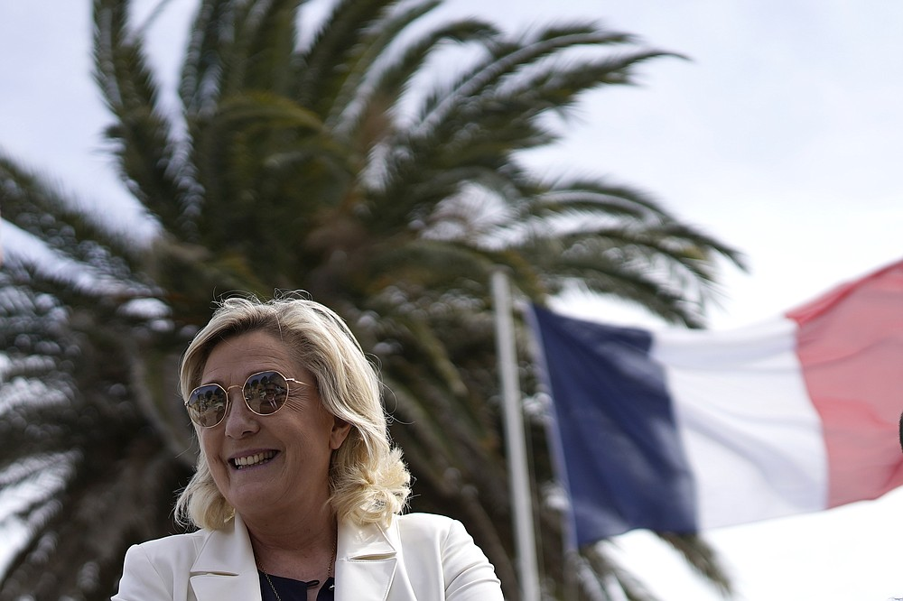 Far-right leader Marine le Pen smiles as he visits a divers school in Frejus, southern France, Thursday, June 17, 2021. Although the winner of Sundays June 20 and 27 in the regional elections will only deal with local issues, Marine Le Pen's Rassemblement National (National Rally) party could for the first time capture one of France's 13 regions. (AP Photo/Daniel Cole)