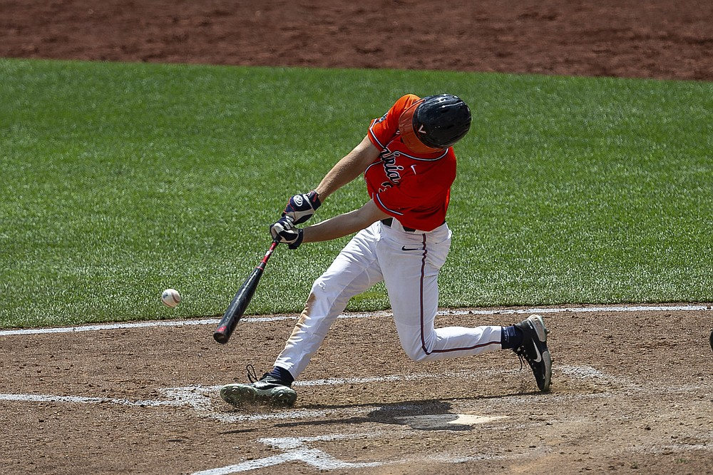 Virginia's Kyle Teel (3) singles in the seventh inning and advanced Max Cotier to third against Tennessee during a baseball game in the College World Series, Sunday, June 20, 2021, at TD Ameritrade Park in Omaha, Neb. (AP Photo/John Peterson)