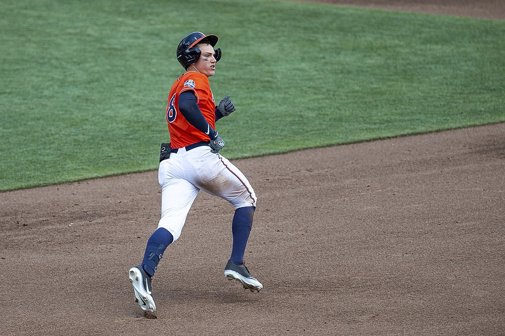 Virginia's Zack Gelof runs after hitting the ball for a double against Tennessee in the third inning during a baseball game in the College World Series, Sunday, June 20, 2021, at TD Ameritrade Park in Omaha, Neb. (AP Photo/John Peterson)