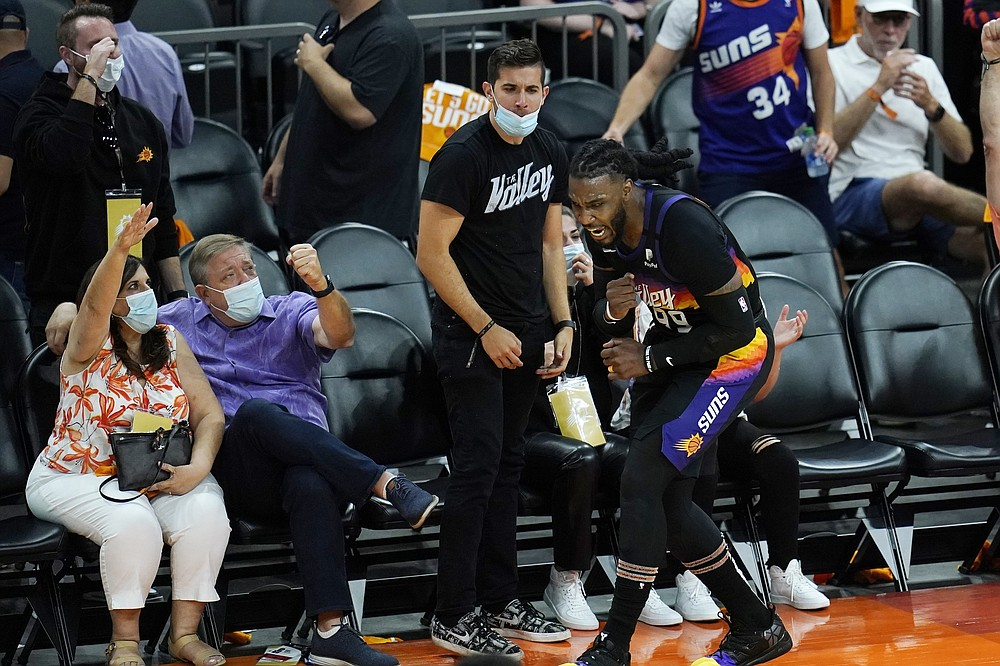 Phoenix Suns forward Jae Crowder celebrates his three-point basket against the Los Angeles Clippers with fans during the second half of Game 1 of the NBA basketball Western Conference finals Sunday, June 20, 2021, in Phoenix. (AP Photo/Ross D. Franklin)