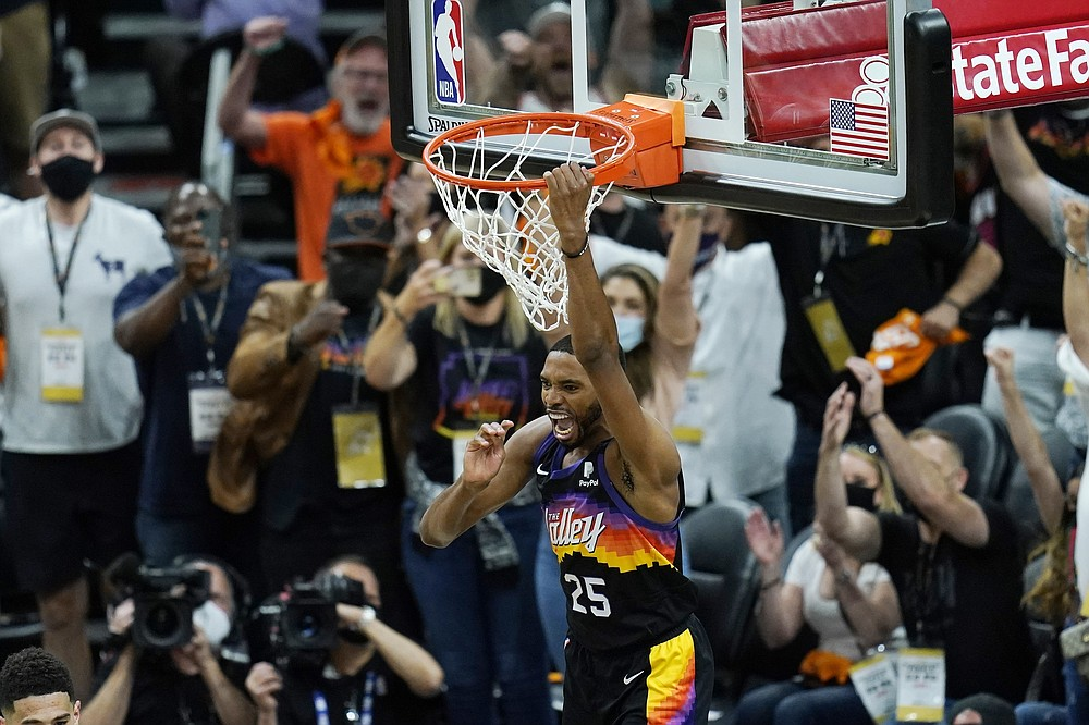 Phoenix Suns forward Mikal Bridges celebrates his dunk against the Los Angeles Clippers during the second half of Game 1 of the NBA basketball Western Conference finals Sunday, June 20, 2021, in Phoenix . (AP Photo/Ross D. Franklin)