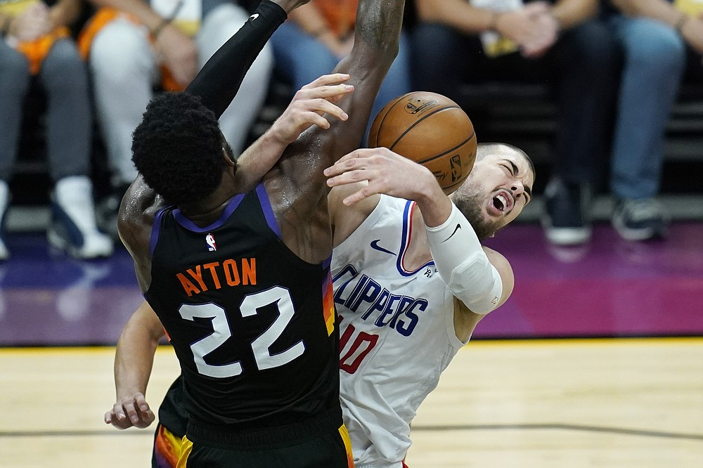 Los Angeles Clippers center Ivica Zubac, right, is fouled by Phoenix Suns center Deandre Ayton (22) during the second half of Game 1 of the NBA basketball Western Conference finals Sunday, June 20, 2021, in Phoenix. (AP Photo/Ross D. Franklin)