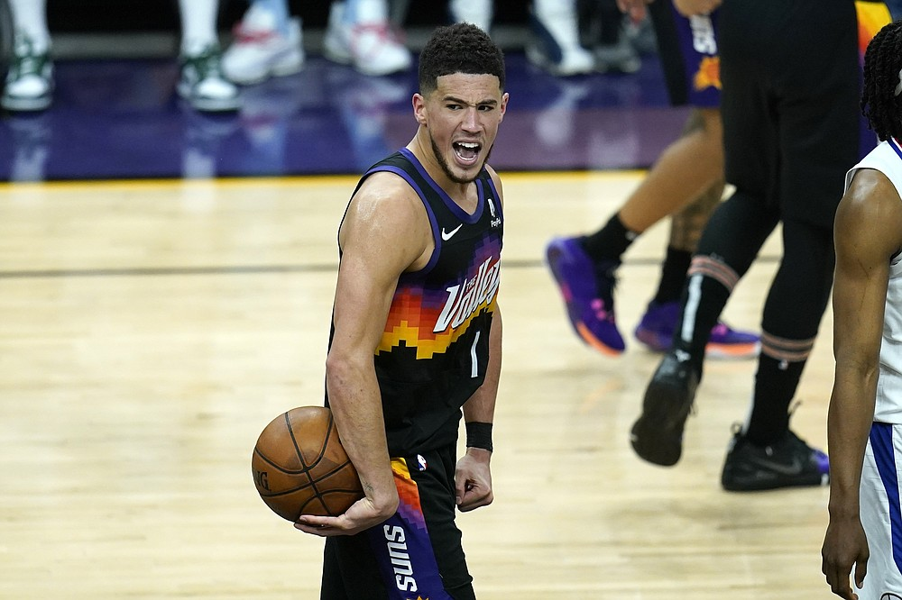 Phoenix Suns guard Devin Booker shouts in celebration in the closing seconds during the second half of Game 1 of the NBA basketball Western Conference finals against the Los Angeles Clippers, Sunday, June 20, 2021, in Phoenix. The Suns defeated the Clippers 120-114. (AP Photo/Ross D. Franklin)
