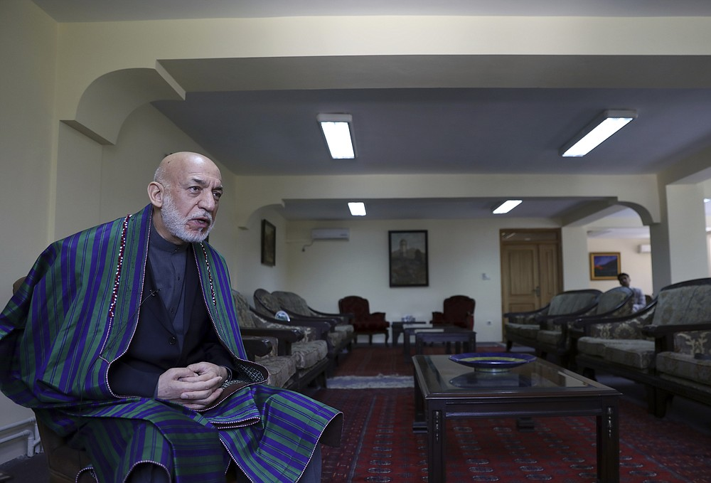 Former Afghan President Hamid Karzai speaks during an interview with the Associated Press at his house, in Kabul, Afghanistan, Sunday, June 20, 2021. Karzai said Sunday the United States came to Afghanistan to fight extremism and bring stability to his war-tortured nation and is leaving nearly 20 years later having failed at both. (AP Photo/Rahmat Gul)