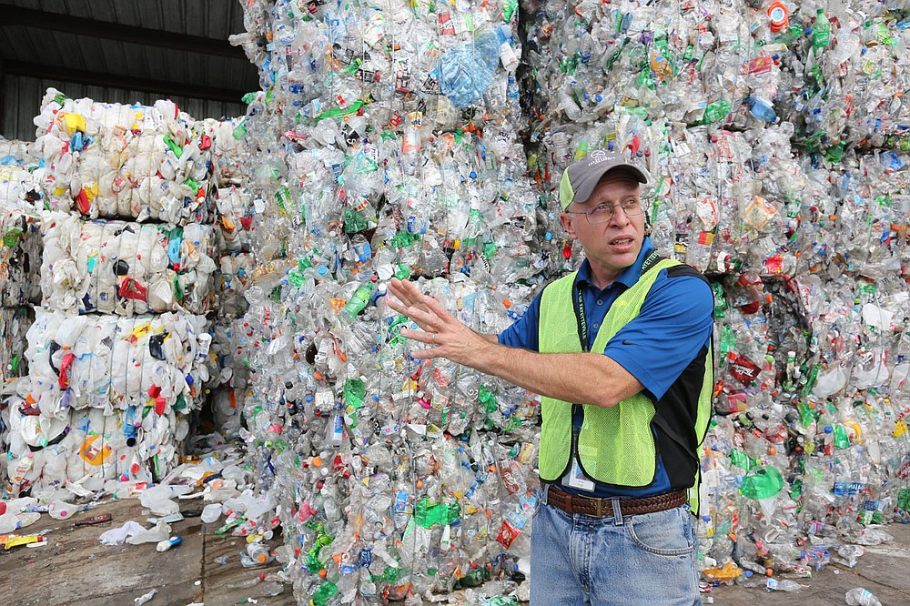 Brian Pugh, waste reduction coordinator with the city of Fayetteville, describes Friday, June 11, 2021, the demand for both number 1 and 2 plastic bottles at the Material Recovery Facility for the Recycling and Trash Collection Division for the city. The Northwest Arkansas Council is proposing a circular economy that makes use of regional recycling programs to create new businesses and jobs and reduce waste. Check out nwadg.com/photos for a photo gallery. (NWA Democrat-Gazette/David Gottschalk)
