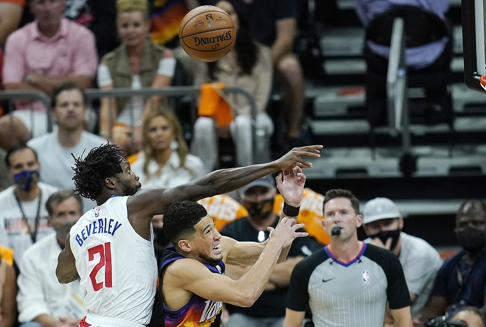 Los Angeles Clippers guard Patrick Beverley (21) fouls Phoenix Suns guard Devin Booker, front right, as the two battle for a rebound during the first half of Game 1 of the NBA basketball Western Conference finals Sunday, June 20, 2021, in Phoenix. (AP Photo/Ross D. Franklin)