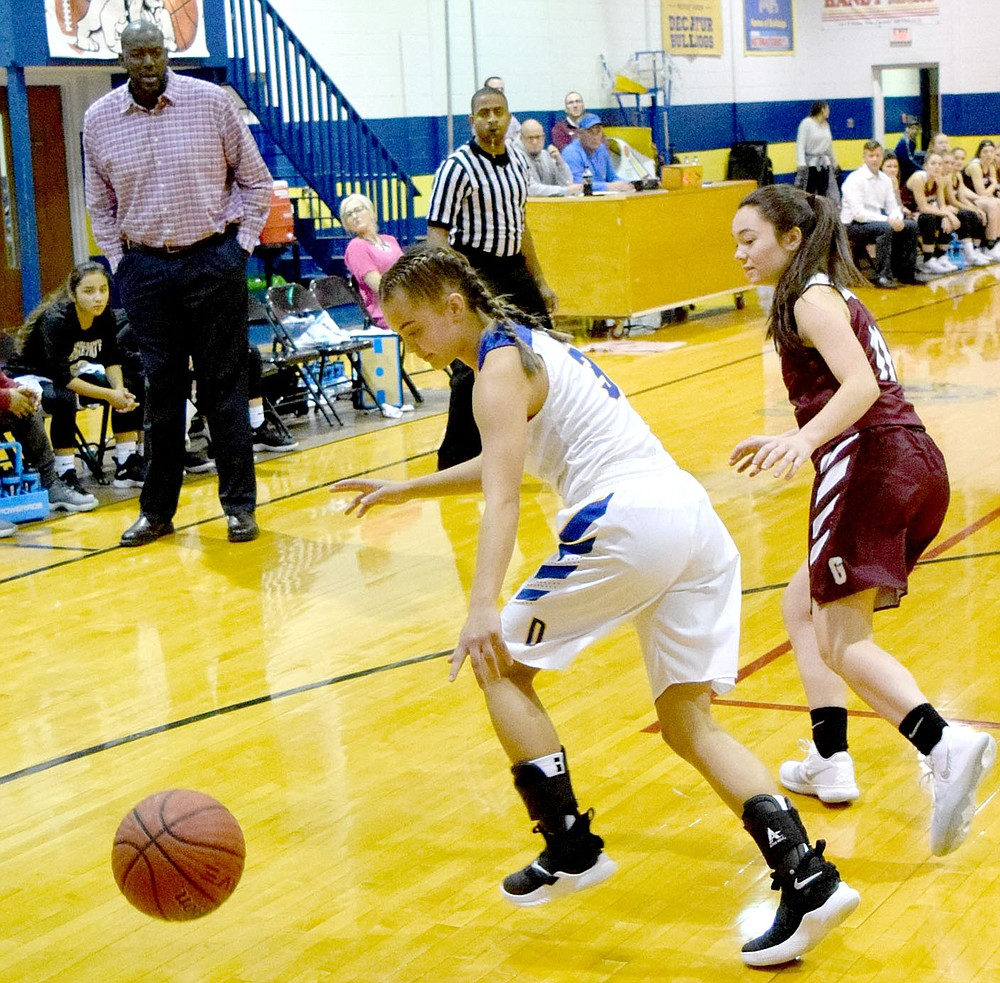 Westside Eagle Observer/MIKE ECKELS  Fess Thompson (top left) watches as Destiny Mejia (3) dribbles the ball away from a Lady Pioneer player during the November 16, 2018 Decatur-Gentry basketball contest in Decatur. The 2018-19 season was Thompson's first coaching assignment for the Lady Bulldogs program. He returns to Decatur to lead the Lady Bulldogs during the 2021-22 season.