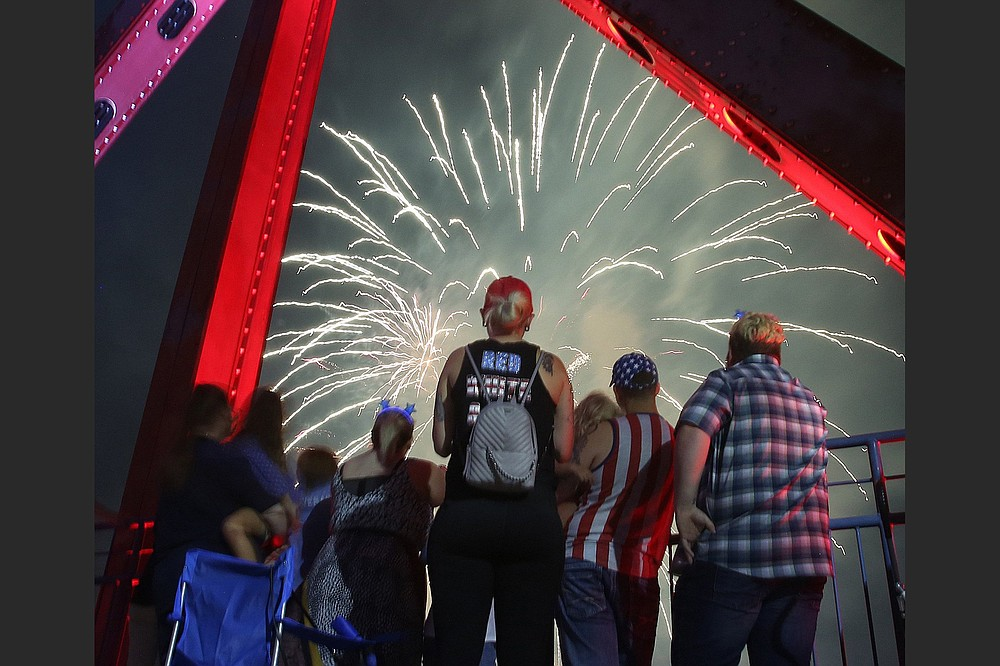 The Junction Bridge over the Arkansas River was a good spot from which to watch the fireworks for 2018's Pops on the River. (Democrat-Gazette file photo)