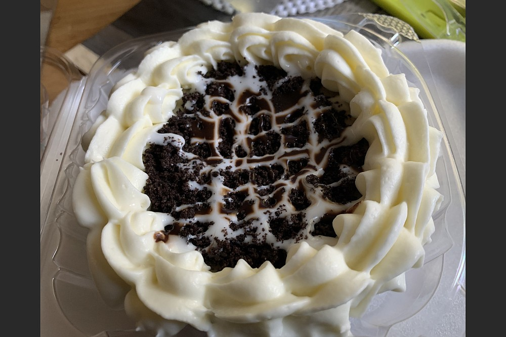 Our personal size (4-inch) cookies 'n cream cheesecake from Cheesecake on Point's new West Markham Street brick-and-mortar location is big enough to feed two, or to feed one, half today and half tomorrow. (Arkansas Democrat-Gazette/Eric E. Harrison)