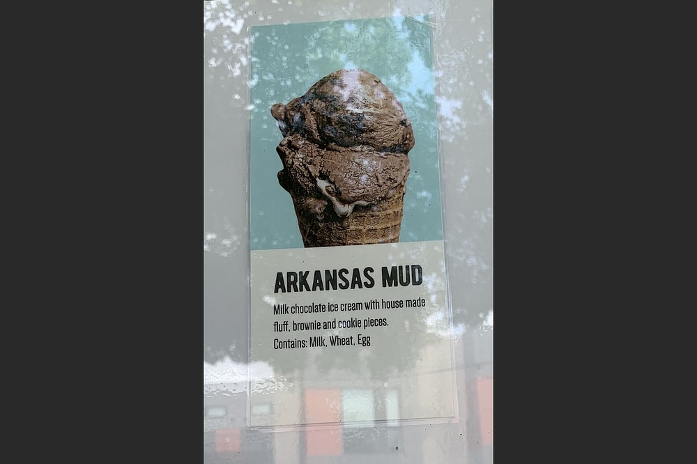 """We couldn't hold our Arkansas Mud ice cream cone from Loblolly Creamery and photograph it, so we settled for """"shooting"""" the in-window menu descripton. (Arkansas Democrat-Gazette/Eric E. Harrison)"""