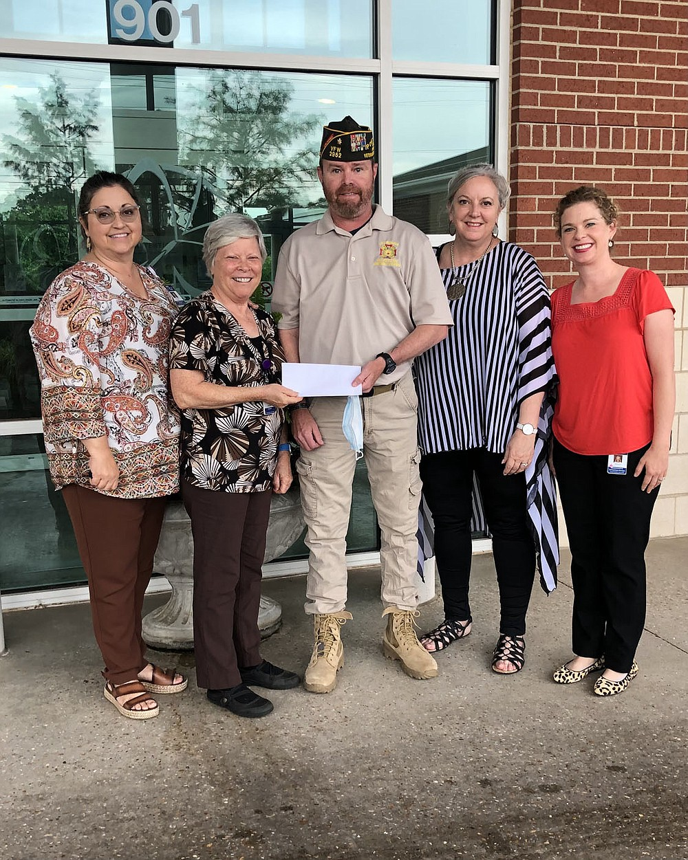 Wade Tharrington, Post Commander of Springdale Veterans of Foreign Wars Post 2952, presents a check for $1000 to Debby Holmes, Chaplain of Circle of Life Hospice in Springdale. VFW Post 2952 and the Post Auxiliary are very excited to be teaming to provide trained volunteers to visit Veteran residents at Circle of Life. (Pictured from left to right: Susan Parish, Debby Holmes, Wade Tharrington, Leslie Karnbach, and Allison Wright.)