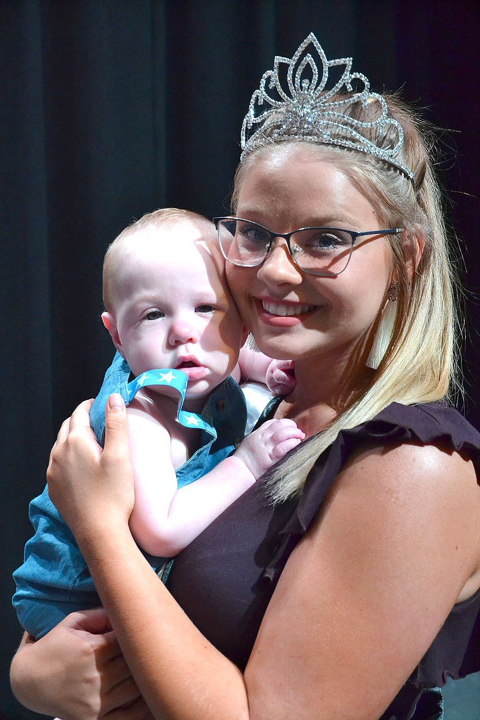 Jr. Miss Pea Ridge Natalie Graham held Sterling Shaver, the winner of the cutest baby contest, Saturday. Shaver is the son of David and Jennifer Shaver.