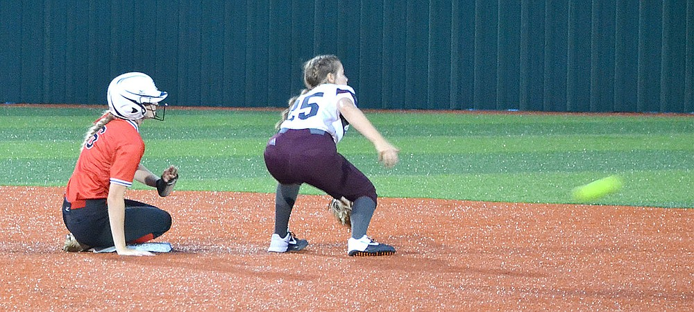 Lady Blackhawk Blakelee Winn (No. 6) made it safely to second base before the softball that was thrown in from the outfield.