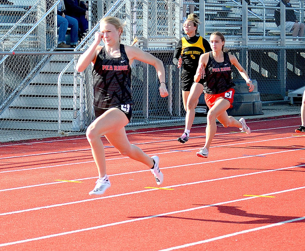 Lady Blackhawk Blakelee Winn, left and Kamree Dye, right, came in first and third in the 100-meter dash Friday, April 9.
