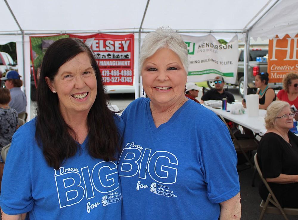 Alice Rappe (left) and Sandy Fisher enjoy the Crawfish Boil. (NWA Democrat-Gazette/Carin Schoppmeyer)