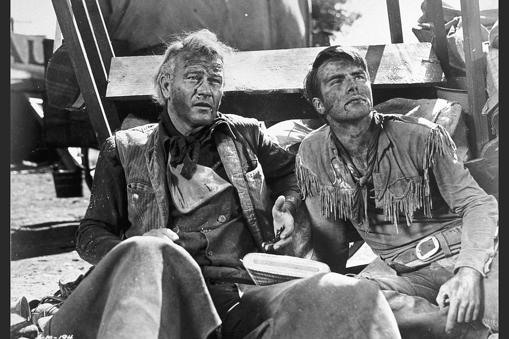 """John Wayne and Monty Clift at the end of """"Red River."""""""