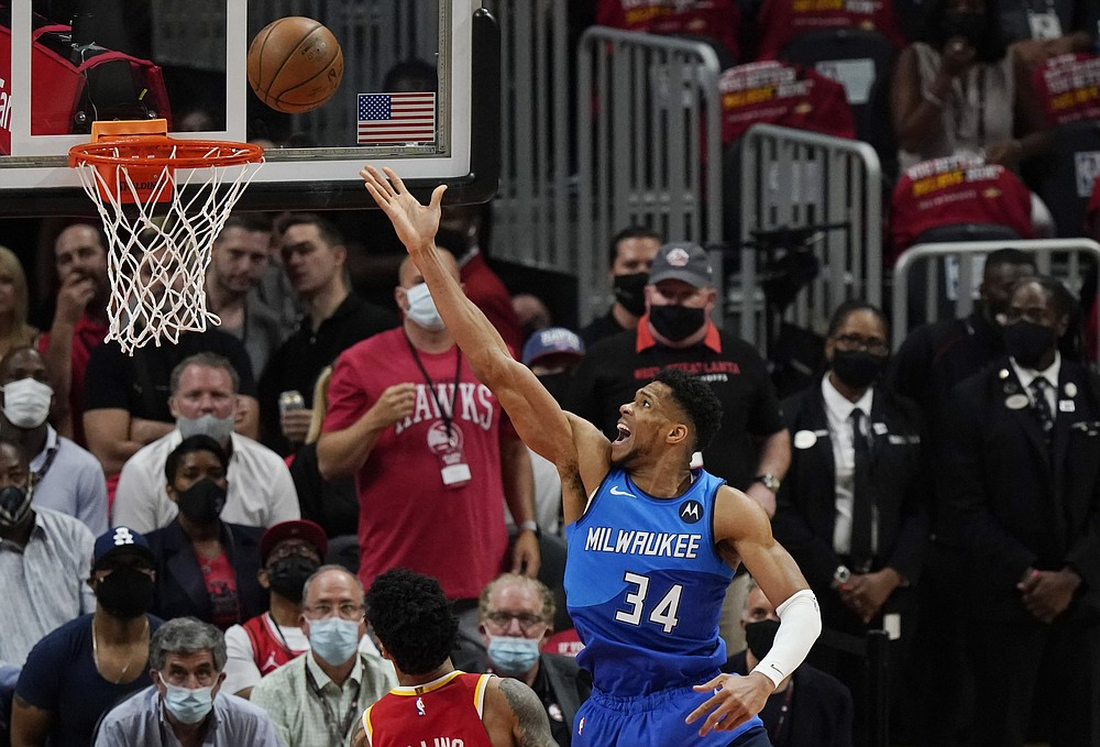 Milwaukee Bucks' Giannis Antetokounmpo (34) scores against the Atlanta Hawks during the first half of Game 3 of the NBA Eastern Conference basketball finals Sunday, June 27, 2021, in Atlanta. (AP Photo/Brynn Anderson)