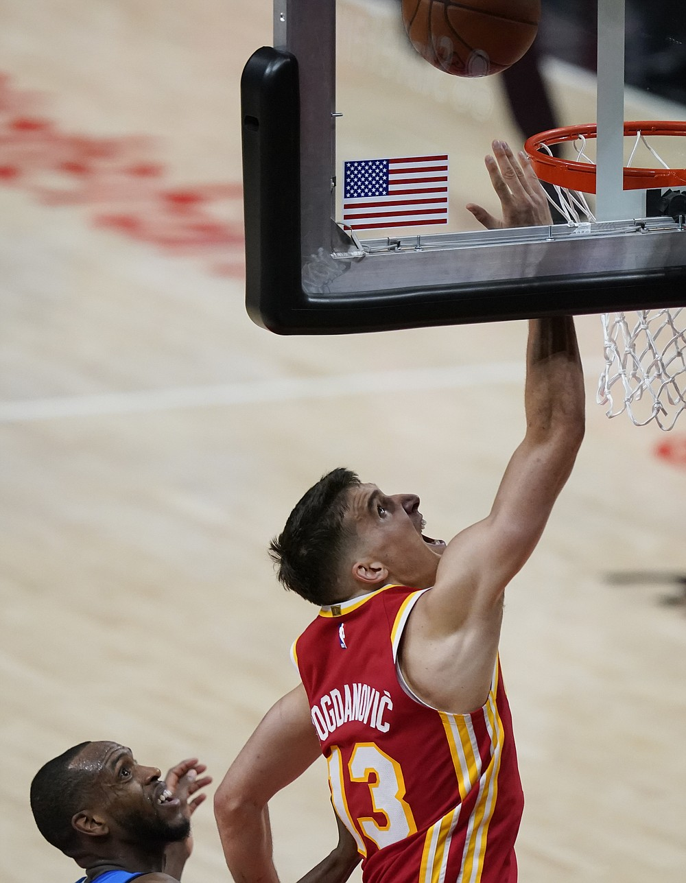 Atlanta Hawks' Bogdan Bogdanovic (13) shoots and scores during the first half of Game 3 of the NBA Eastern Conference basketball finals against Milwaukee Bucks Sunday, June 27, 2021, in Atlanta. (AP Photo/Brynn Anderson)